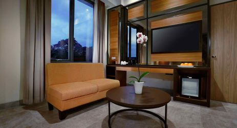 Suites room with adjoined living area and private balcony to enjoy mountain breeze in modern stylish classy hotel in mataram lombok