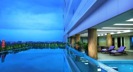 The inviting outdoor swimming pool surrounded by open-air deck and sun loungers from which to enjoy the relaxing atmosphere of Madiun sky