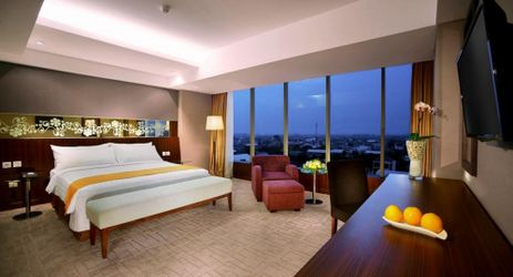 Contemporary and chic complete with imaginative artwork of 40 square meter Premier Rooms offering pool and Mount Wilis or Lawu view ideal for family or business people come to Madiun