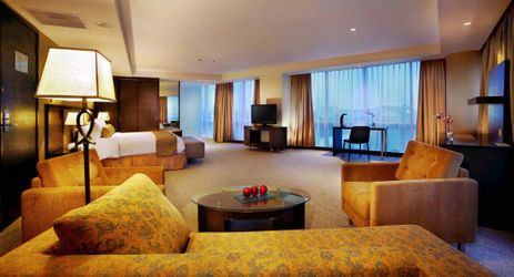 A stylish and spacious room with living room, design with full of glass heading the city view in makassar