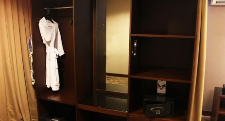 A built-in wooden wardrobe to keep your clothes tidy while staying in the commercial center of North Jakarta