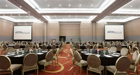 Modern ballroom completed with sophisticated meeting equipment for business gathering in the best hotel surrounded by mountain view in Sentul area