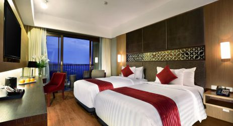 A charming bedroom with wooden floor panel to relax while staying in the best hotel surrounded by mountain view in Sentul area