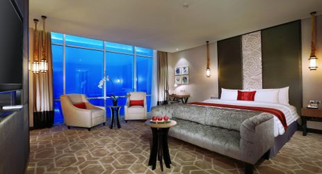 A spacious room which is completed with comfortable sofa and beautiful city view from the window in the center of business district in South Jakarta