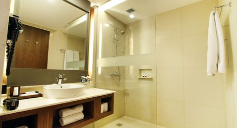 Grand Aston Yogyakarta Bathrooms at Grand Aston Yogyakarta are equipped with a standing shower or bathtub, a hairdryer, towel warmer, bathrobes, slippers and complimentary, luxury toiletries