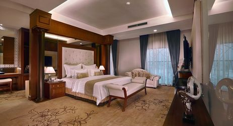 The luxurious presidential Suite with the finest furniture and comfortable interior featuring king size master bed, living room, kitchenette, dining room and meeting room, also conected to premier deluxe room.