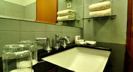 Pamper yourself in bathroom with rain shower and full of amenities based on ASTON standard