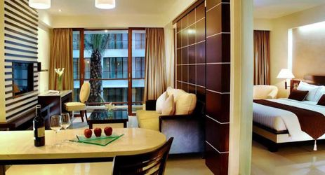 Luxury suite room with living and dining room and equipped pantry in Kuta bali