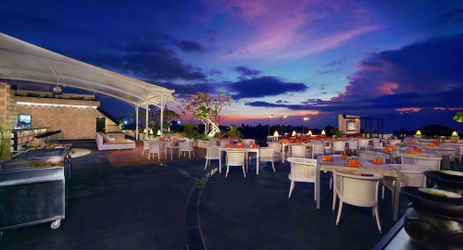 Rooftop lounge with sunset view to enjoy meals drinks and BBQ in Kuta bali
