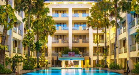 A tropical setting swimming pool chill out and enjoy the clear blue sky and sunny day in kuta bali
