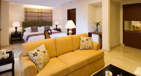 Modern room for VIP guest with classic design and adjoined living area in manado
