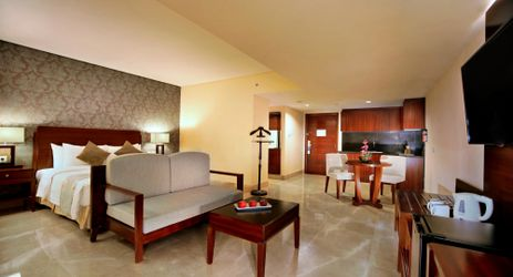 A clean, comfortable and spacious room with kitchen set, couch, dining table and Queen-size bed a perfect place to sleep or relax while have a business or holiday in Samarinda.