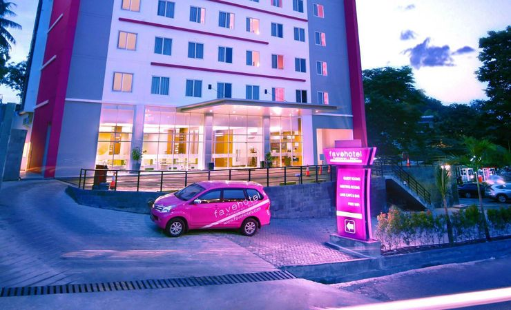 Easy to find a Building with Pink Color Building, large parking lot for 70 cars.