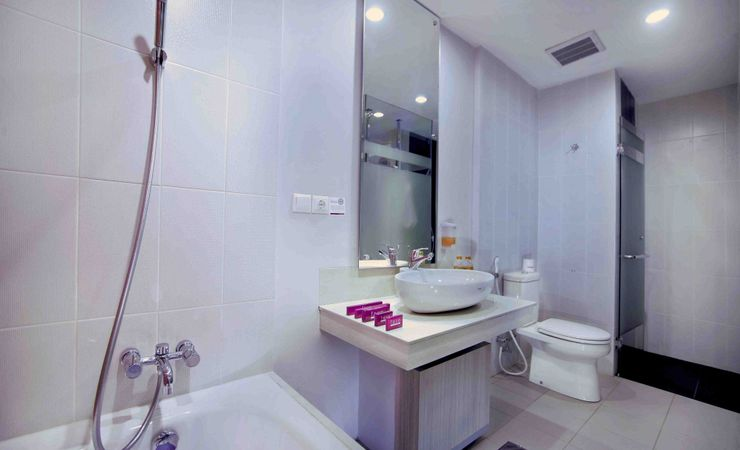 A clean bathroom with shower and bathtub
