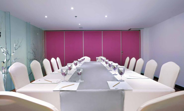 A small indoor function room to host business meeting, workshop, training or wedding, birthday party or any reception in a budget hotel in Kuta Bali