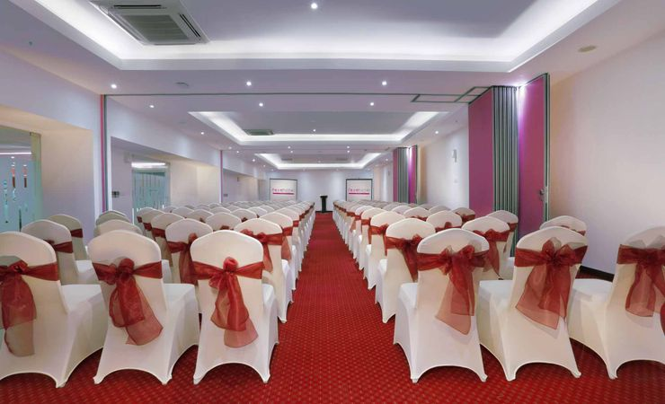 A large indoor function room to host business meeting, workshop, training or wedding, birthday party or any reception in a budget hotel in Kuta Bali