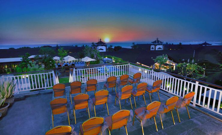 A beautiful rooftop function room with ocean and sunset view to host wedding, birthday party or other reception and social events in a budget hotel in Kuta Bali