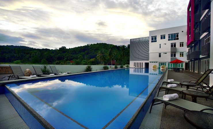 A relaxing swimming pool area to chill out and enjoy the clear blue sky and sunny day.