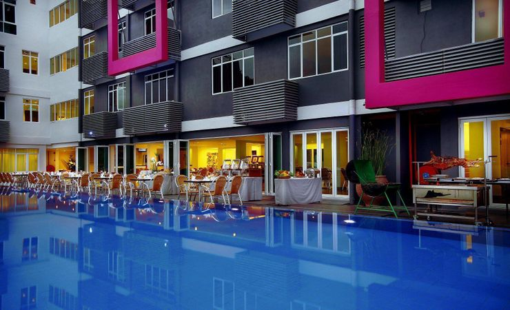 Have private dinner by the pool with outdoor scenery