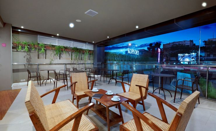 An outdoor area to chat with your friends while looking at the city view of Margonda area