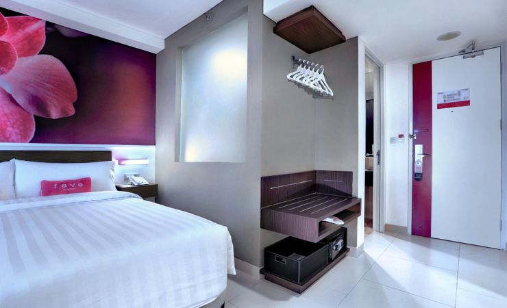 A comfortable room supported with cool air conditioner, safety deposit box, and other supporting room amenities