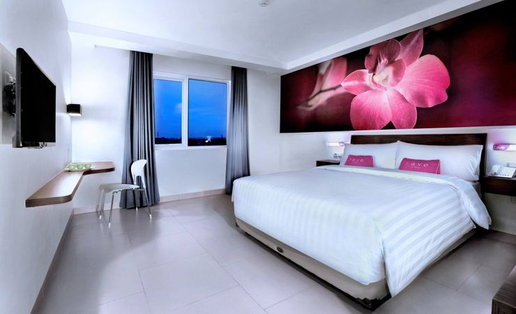 A stylish bedroom with comfortable bed and top quality room amenities which is suitable for business trip and family guest