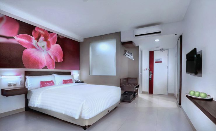 A spacious bedroom with top quality amenities completed by beautiful Depok city view.