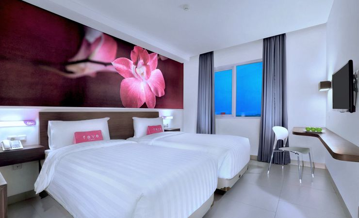 A comfortable room with beautiful view of Depok city directly through the window
