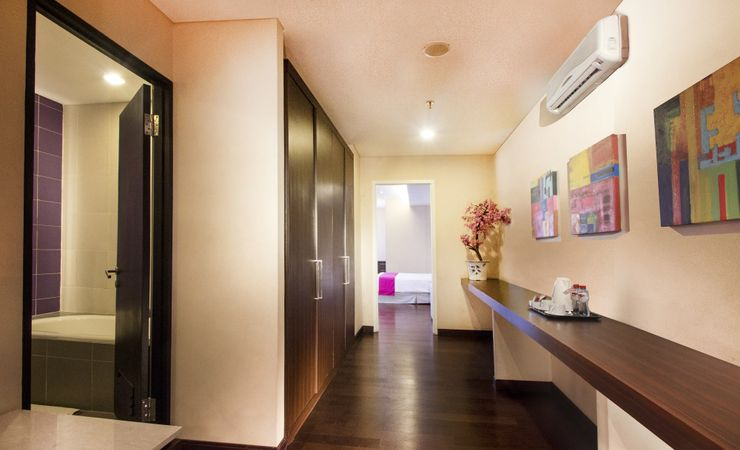 A spacious space to enjoy clean and comfort room with minibar and sofa inside