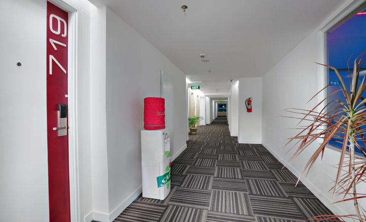 A simply-designed hotel corridor inside the hotel