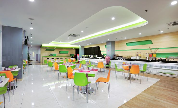 Colorful restaurant with touch of orange, green, and pink color