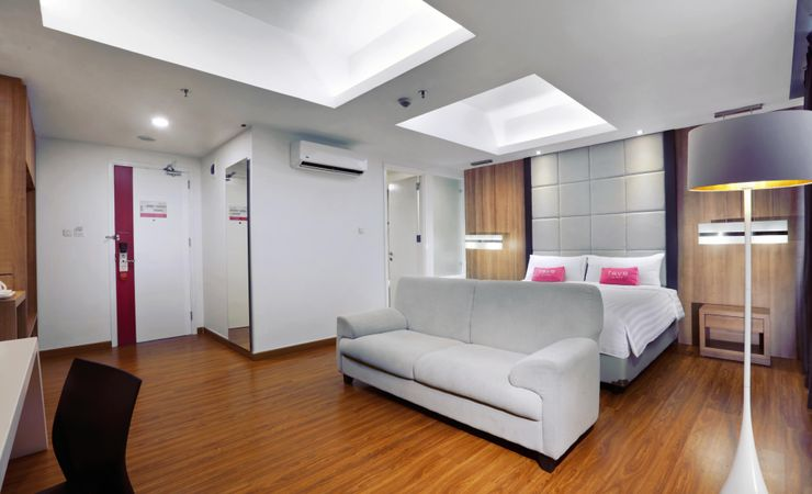 A stylish bedroom which is suitable for business trip and family guest
