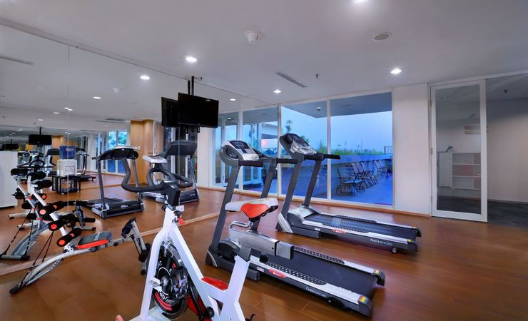 get healthy exercise at gym area near swimming pool on 5th floor