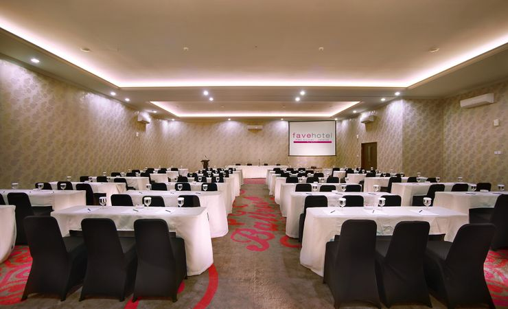 A large indoor function room to host business meeting, workshop, training or wedding, birthday party or any reception in a budget hotel in East Jakarta