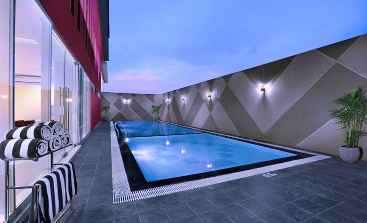 A relaxing swimming pool area to chill out and enjoy holiday and clear blue sky in Rungkut - Surabaya