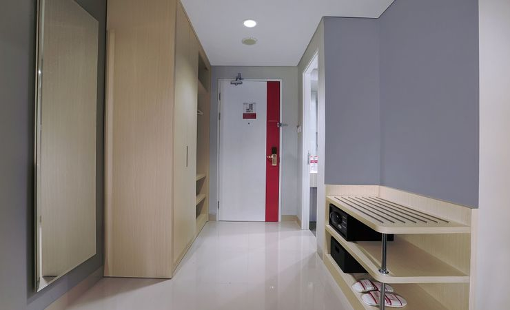 A simply appointed wardrobe with safe deposit box in a budget hotel to stay while you come and stay at Bojonegoro City