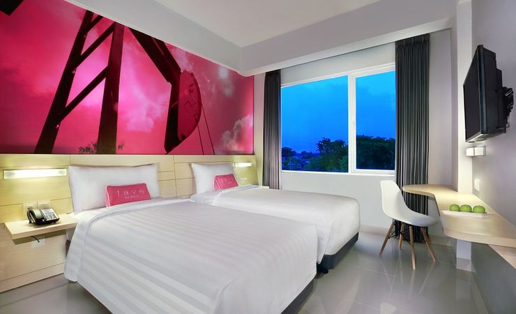 A fresh and energetic room with twin size bed of a budget hotel while you come and stay at Bojonegoro City