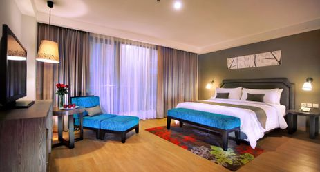 A clean, comfortable and spacious Deluxe Room with queen bed during holiday in Bali
