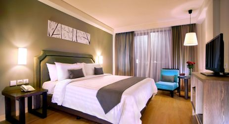 A clean, comfortable and spacious Superior Room with queen bed during holiday in Bali