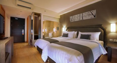 A clean, comfortable and spacious Superior Room with sharing twin beds during holiday in Bali